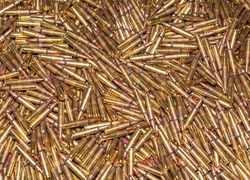 A pile of ammunition of classic 223 caliber