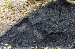 a pile of black coal
