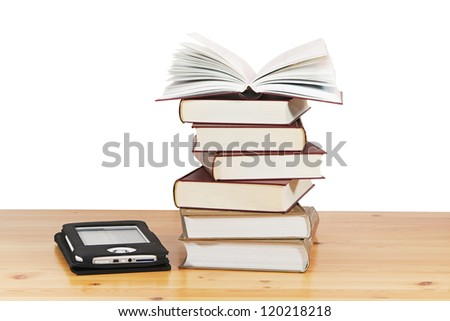 A pile of books and e-book on wood table against a white background