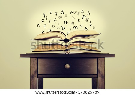 a pile of books and letters floating over them on a desk symbolizing the idea of literature or knowledge