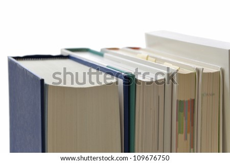 A pile of books on a white background