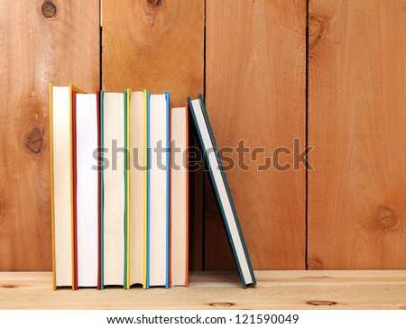 a pile of books on wooden table