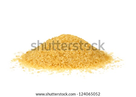 a pile of brown granulated sugar on a white background