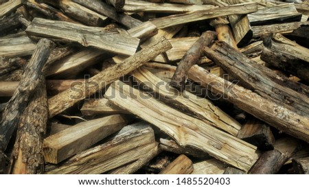 A pile of burnt lumber, burnt lumber are stacking together.  #1485520403