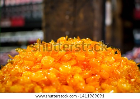 A pile of butterscotch candy #1411969091