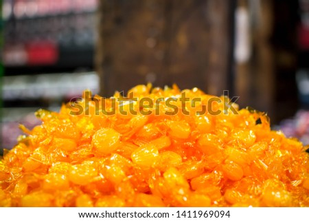 A pile of butterscotch candy #1411969094