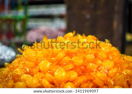 A pile of butterscotch candy #1411969097