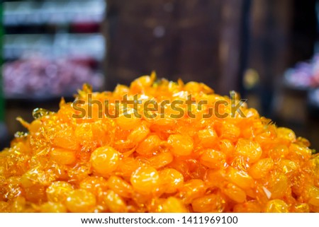 A pile of butterscotch candy #1411969100