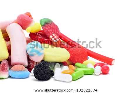 a pile of candies on a white background