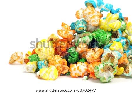 a pile of caramel corn of different colors on a white background
