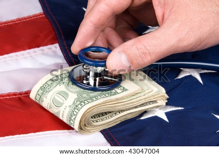 A pile of cash being examined with a stethoscope for signs of life.  Image is good for medical or economic inferences.