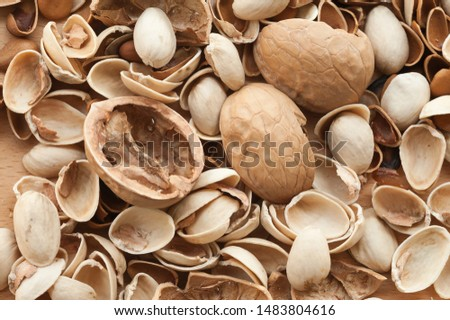 a pile of chaotic nut husks to be discarded