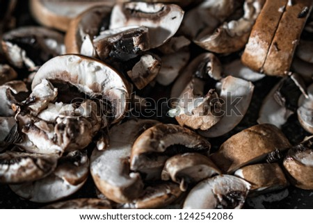 A pile of chopped brown mushrooms shot in natural light.