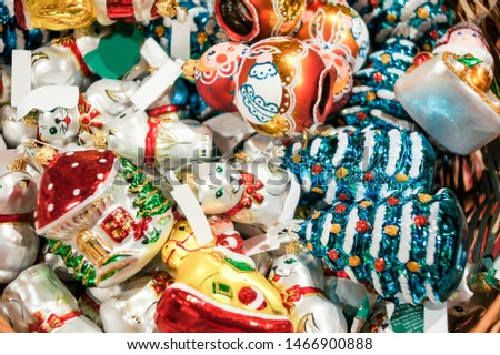 A pile of Christmas toys. Christmas tree decorations and decorations in the design.