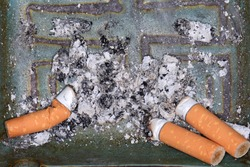 A pile of cigarette butts end stubs, butts, ash background