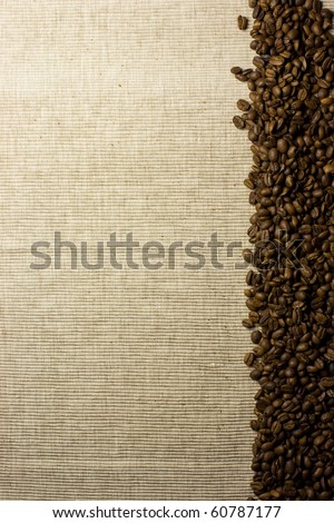 A pile of coffee beans forming a simple stripe frame on a natural background.