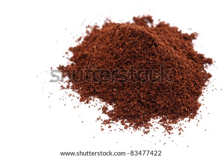 a pile of coffee grain isolated on white