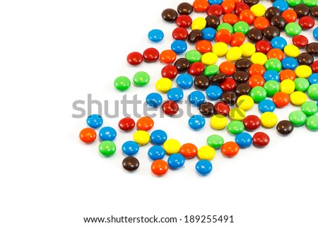 A pile of colorful chocolate coated candy