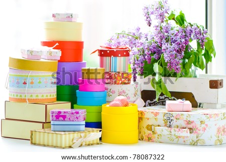 A pile of colorful gift boxes isolated on white