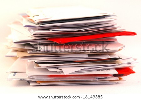 A pile of colorful letters and junk mail on a table isolated on white background