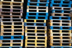 a pile of colorful pallets at Western District Public Cargo Working Area, Kennedy Town, Hong Kong