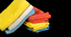 A pile of colorful shop rags shot against a black background