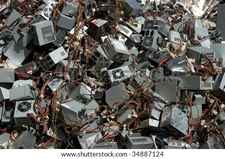 A pile of computer power supply boxes for recycling