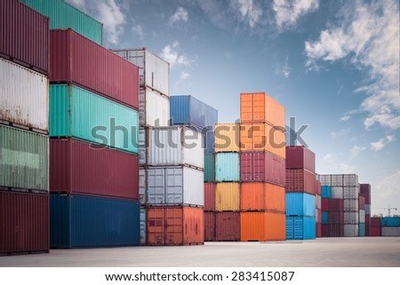 a pile of container in freight yard against a blue sky, transport background