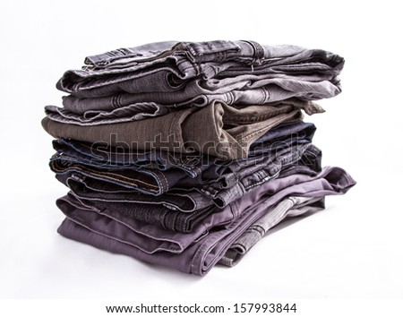 A pile of dark jeans