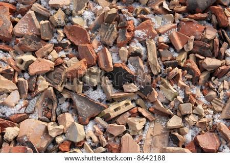 A pile of debris, broken pieces of brick