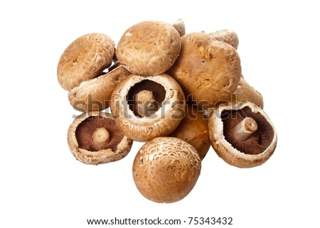 A pile of delicious fresh swiss brown mushrooms isolated over a white background.