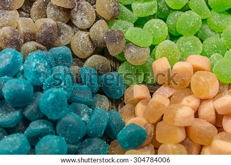 a pile of different candies - Shutterstock ID 304784006