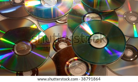 A pile of dirty compact discs