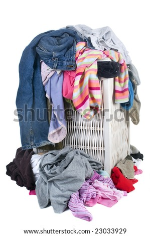A pile of dirty laundry. Children's clothes never end. Isolated on white
