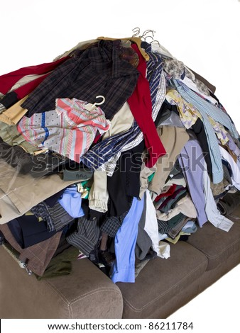 A pile of dirty laundry. Many clothes on bed