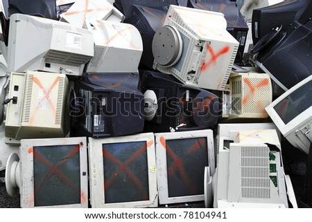 A pile of discarded computer monitor and equipment ready for recycling.