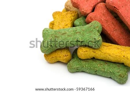 A pile of dog treats isolated on a white background, dog treats