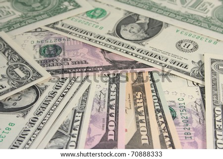 a pile of dollar bills in front of white background