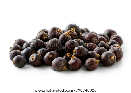 A pile of dry juniper berries isolated on white. #790740028