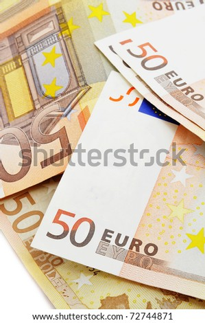 a pile of 50 euros bills on a white background