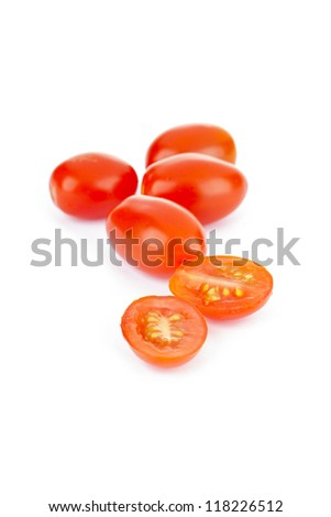 A pile of grape tomatoes with tomato sliced - stock photo