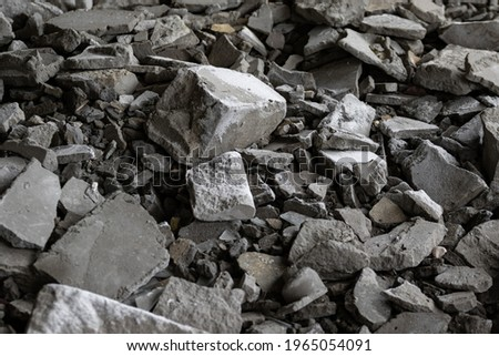 A pile of gray brick and construction debris after the roof collapsed or the wall of an apartment building fell a lot of broken concrete in an abandoned building a pile of industrial white stones.  Stock photo ©