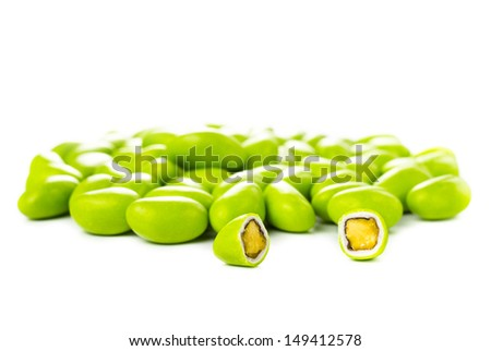 A pile of green gumballs with nuts isolated  on a white background.