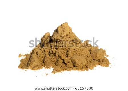 A pile of ground coriander isolated on a white background