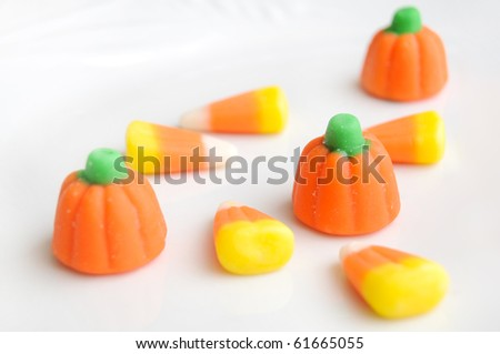 A pile of Halloween candy corn on a white background.