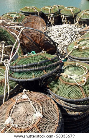 A pile of Lobster pots and fishing net on the dock ready to be loaded on the fishing boat