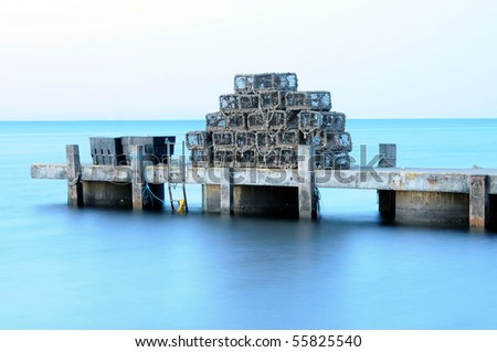 A pile of lobster pots, stacked on a jetty. Swanage, Dorset
