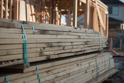 A pile of lumber at a new home construction site.