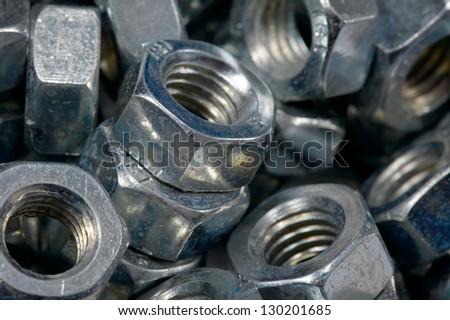 A pile of metal nuts