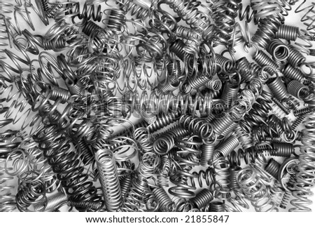 A pile of metal springs of various sizes for use as any mechanical inference.